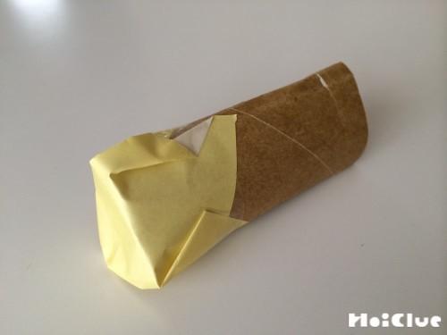 端を折り紙で封をする