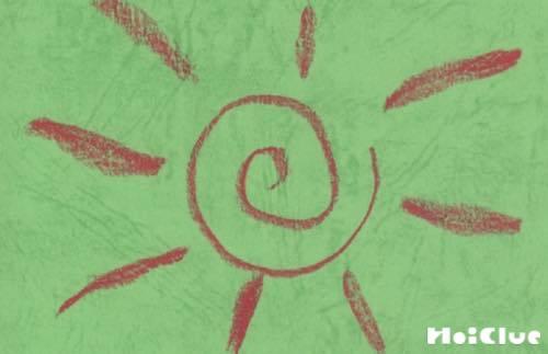 うず巻の周りに線を描いた太陽のようなイラスト