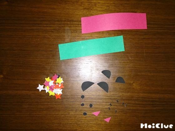 折り紙で作った織姫と彦星のパーツの写真