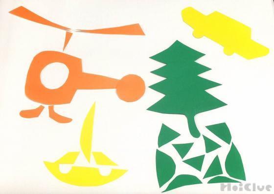 画用紙を切って作ったヘリコプターや車や木の写真