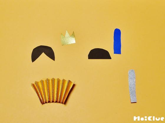 折り紙で作った髪の毛などのパーツの写真