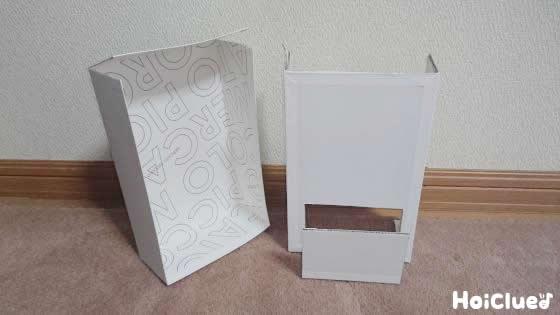 縦にした外箱の上部は動くよう切り込みを入れ、内箱の上部は切り取り下部も切り取出口を作った様子