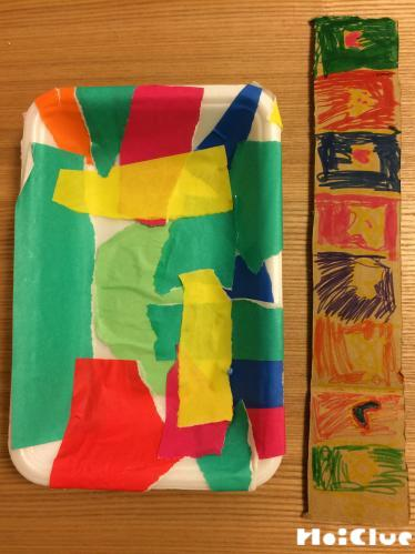 折り紙などで付けしている写真