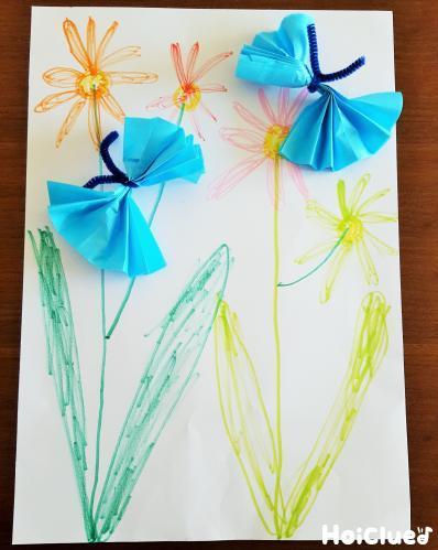 お花の絵にちょうちょを貼った写真