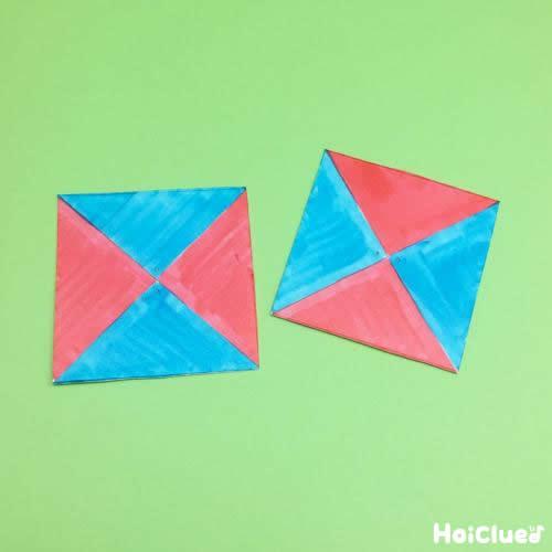切り取った正方形に色をつけ2箇所穴を開けた写真