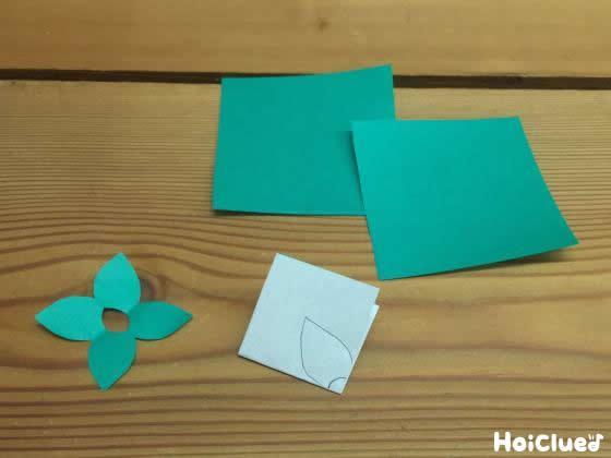 緑の折り紙でヘタの部分を作っている写真