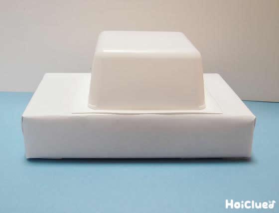 豆腐の容器を上にかぶせた写真