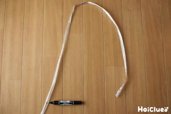 スズランテープの長さを図っている写真