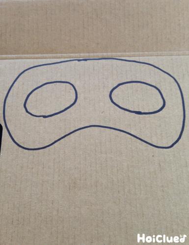 厚紙にメガネを絵を描いた写真
