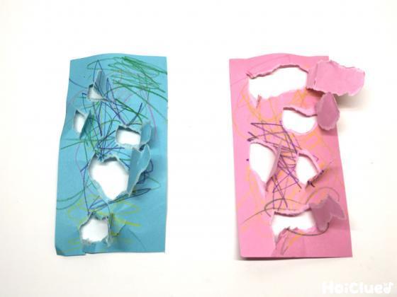 画用紙に絵を描き穴を開けた写真