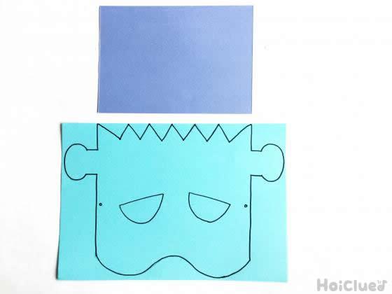 色画用紙に顔を描いた写真