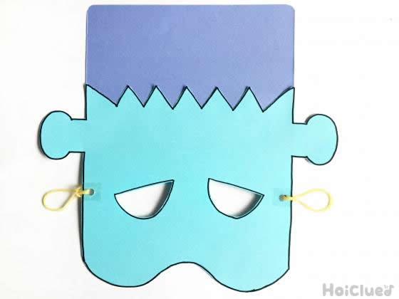 顔を切り取って頭の部分を貼り付けて耳にかけるところ二輪ゴムをつけた写真