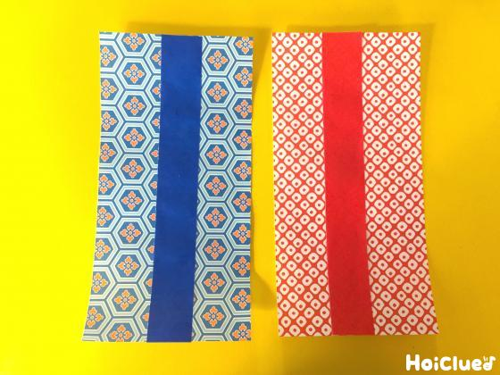 おりがみを長方形に切って着物の部分を作成した写真