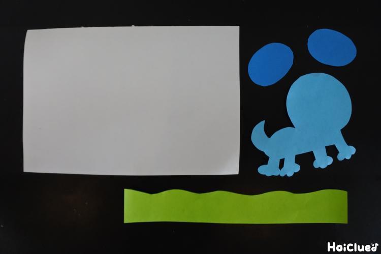 ハガキと画用紙で作った犬の写真