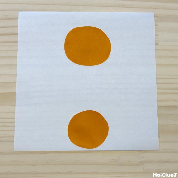 折り紙を丸くきりとった写真