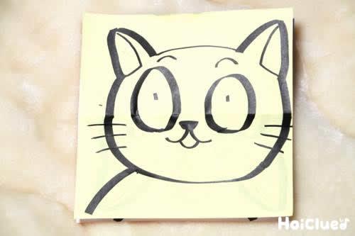 折り紙に猫の絵が描かれた写真