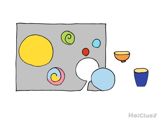 画用紙に渦巻きの絵を描き色付けしたイラスト