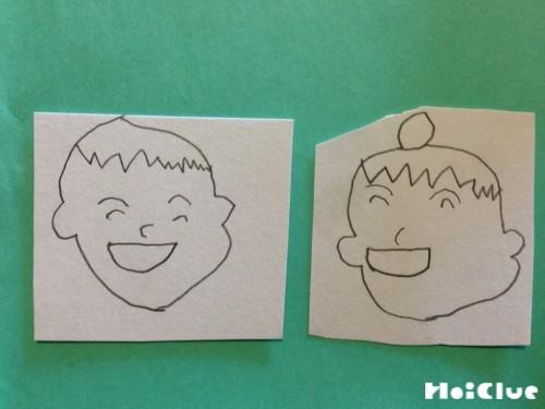 画用紙に顔の絵を描いた写真