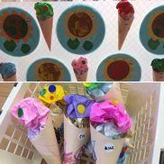 【夏の制作 アイスクリーム】1、2歳児画用紙、クレヨン、折り紙、丸シール、両面テープ子どもたちは折り紙をくしゃくしゃに丸めたり好きな色のクレヨンを選んでコーンに色をつけました♪トッピングのシールも美味しそうです