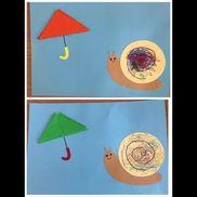 折り紙の傘とカタツムリ
