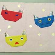 2月制作1.2歳目玉や口、周りの豆(金シール)はシールで自由に貼る赤、青鬼は皆同じで残り1つは色々な鬼の色から子どもが選んだ材料 折り紙、シール