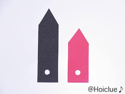 画用紙で作った大小2本の時計の針の写真