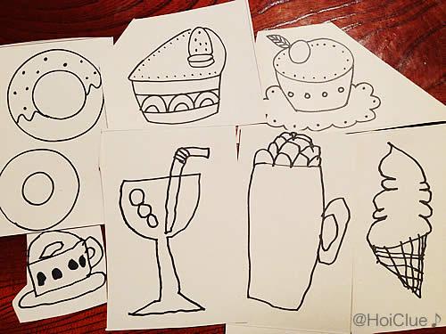 食べ物を描いた画用紙の写真
